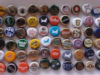 Lote de 54 tampinhas de cervejas para coleção